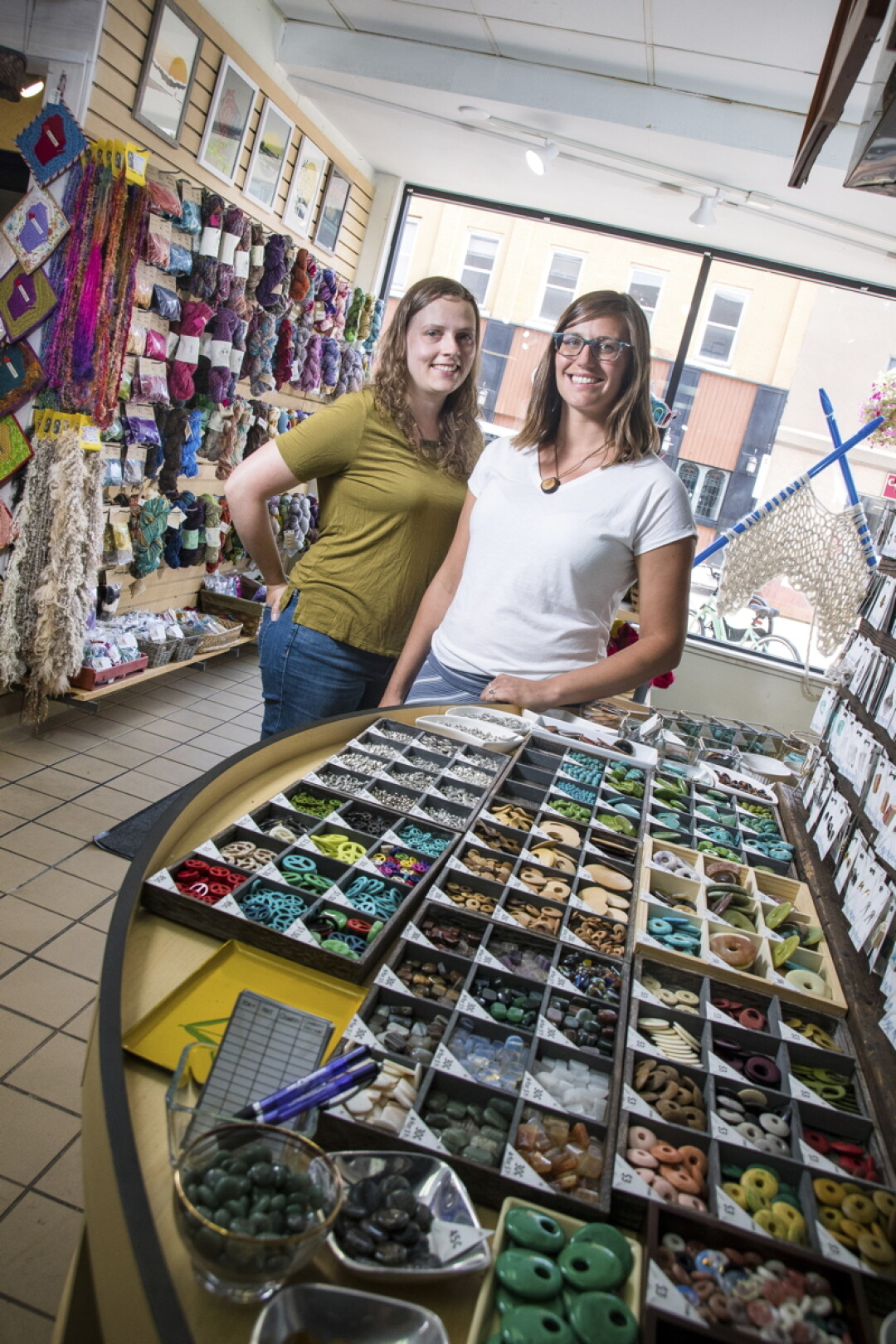 NICE THREADS. Above: Blue Boxer Arts/Tangled Up in Hue owners Erin Klaus and Jamie Kyser. Blue Boxer Arts features locally created fibers and beads, as well as classes and crafty meetups.