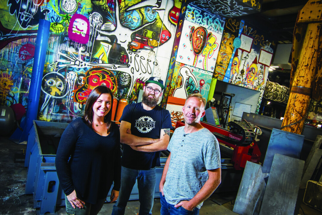 "Artisan Forge Studios – a community of artists and makers housed at 1106 Mondovi Road in Eau Claire – will host their Uptown Art Jam on Saturday, Oct. 21 from 9am to 8pm. Above: Facility Director Jackie Boos (left) and owner Greg Johnson (right) are inspired by the ""energy of the local art community."""