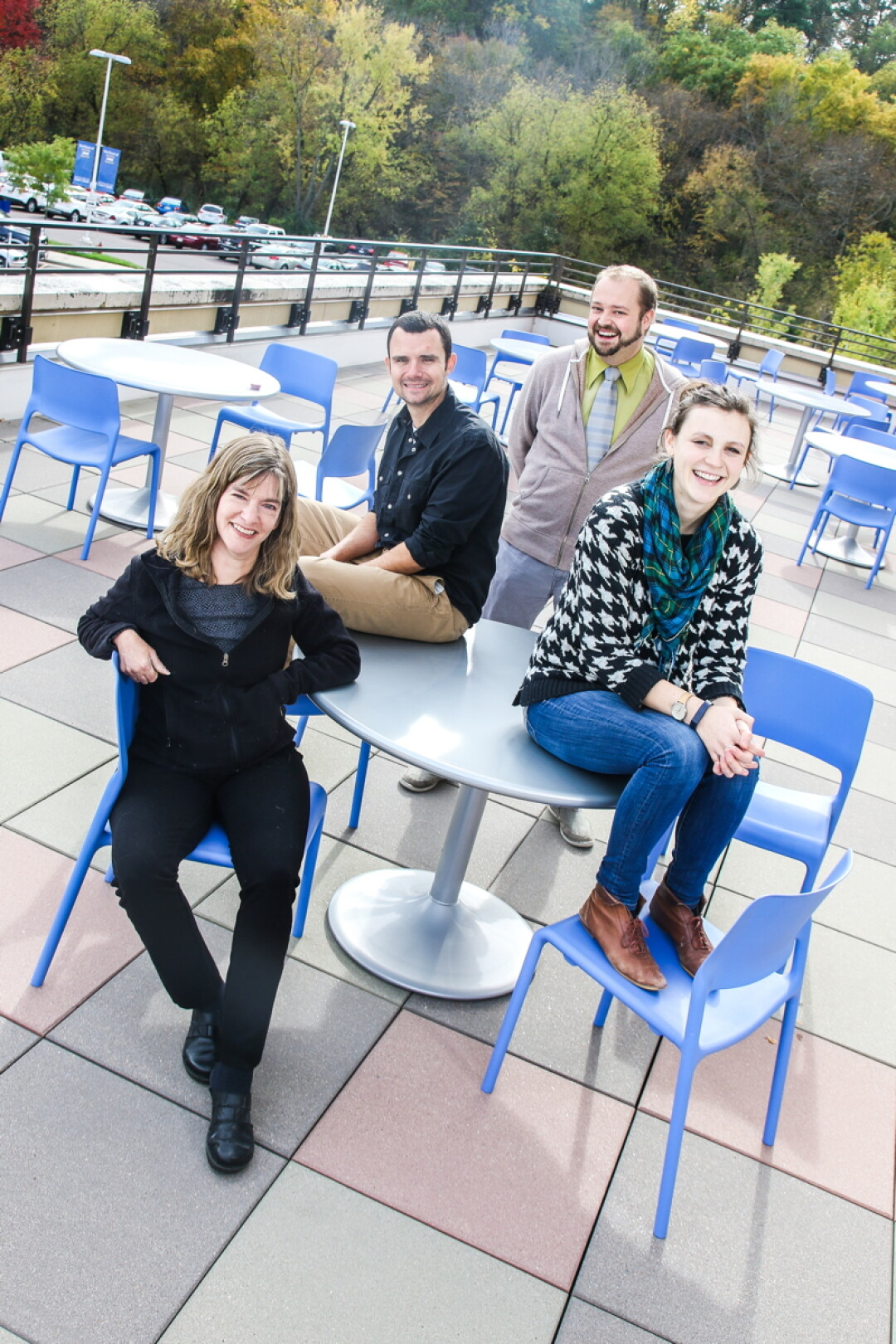 THEY'VE GOT THE WRITE STUFF. The team behind Barstow & Grand, a new Eau Claire-based literary journal, includes (clockwise from lower left) Kate Hinnant, B.J. Hollars, Eric Rasmussen, and Charlotte Kupsh.