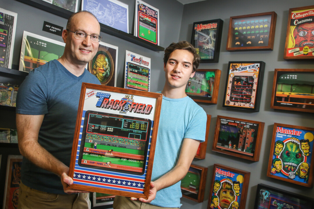 THIS ISN'T A GAME! Jackson Sandler, 15, and his father, Stuart, have created a business making and selling pop-culture themed shadowbox art from their Eau Claire home.