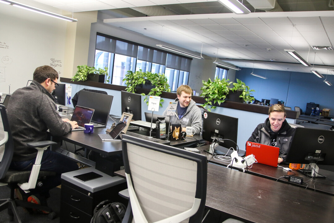 GET WITH THE PROGRAMMING. Jamf employees get down to work at the company's Eau Claire office. A Texas tech firm recently made a majority investment in the company.