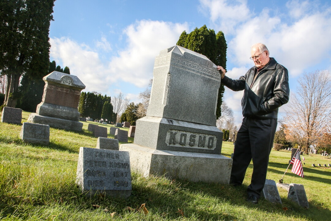 FAMILY HISTORY. Author and Eau Claire native Jim Kosmo visits the family plot at the Northside Lutheran Cemetery on Omaha Street, a location featured in his new book, Monsters in the Hallway.