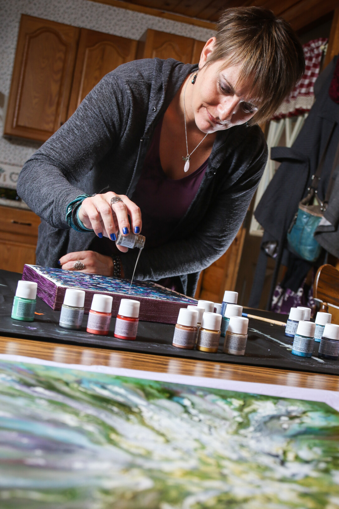 LET THE SPIRIT MOVE YOU. Artist Tanya Meyer creates one-of-a-kind art by pouring paint.
