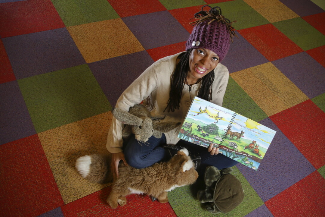 FURRY FRIENDS. Ava Gustafson (above) shows off a proof copy of her new book, which includes colorful illustrations by former Spooner art teacher Katrina Dohm (below).