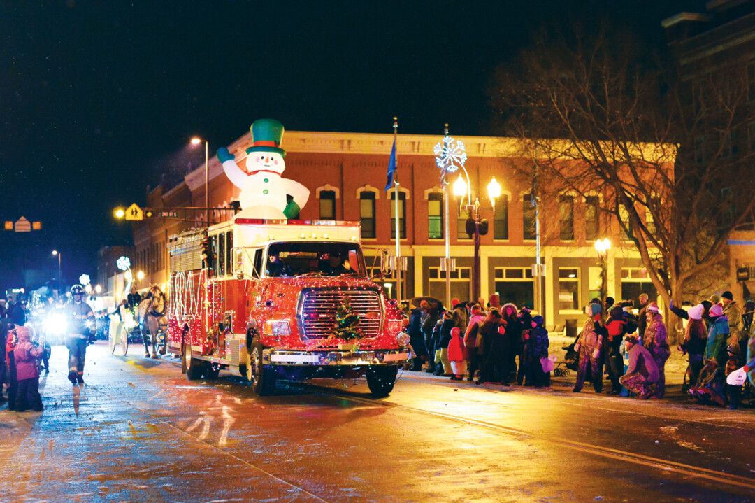 SNOWBODY GETS IN OUR WAY. The 14th Annual WinterDaze Parade paraded through historic downtown Menomonie on the night of December 14, culminating in a winter fireworks show over Lake Menomin.
