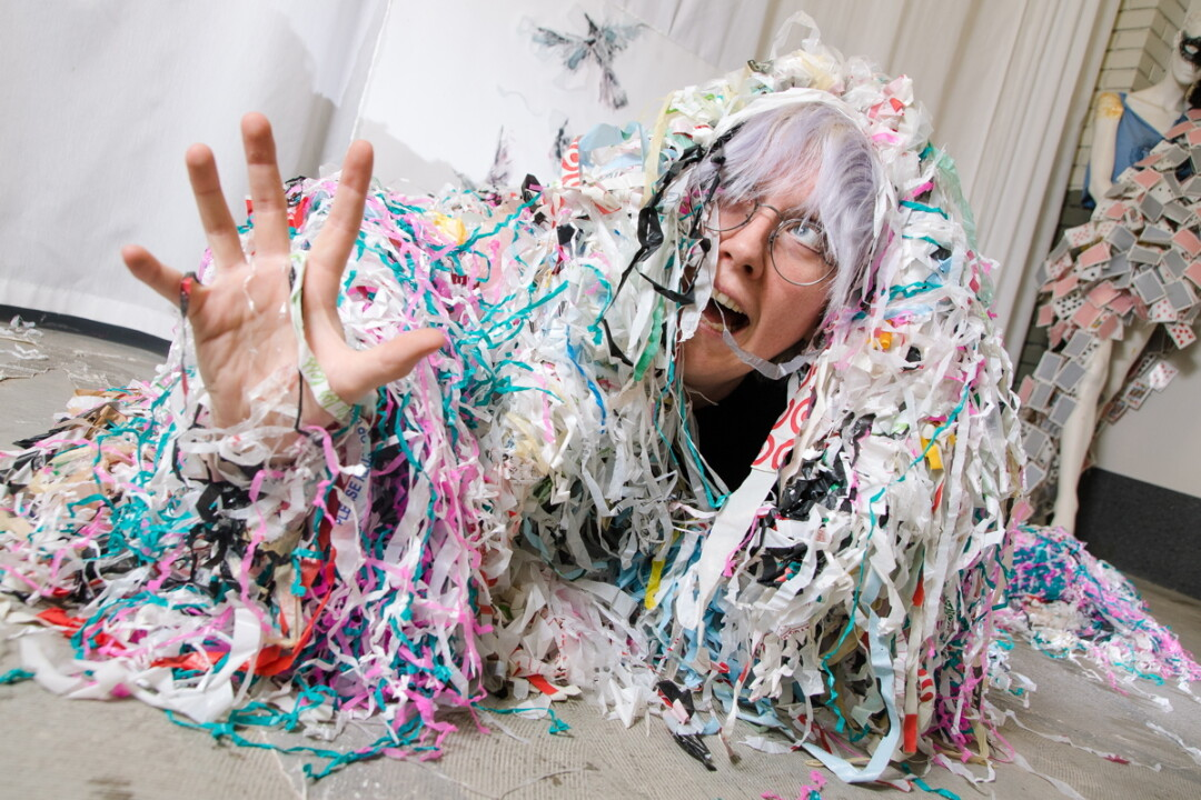 PORTRAIT OF THE ARTIST STRUNG OUT. Eau Claire-based artist CV Peterson, whose work ranges from painting to performance, deals largely in plastic scraps.