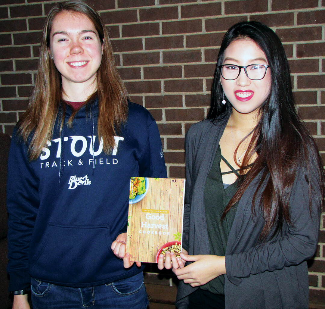SLOWLY REVOLUTIONIZING FOOD. Cookbook project leads Lauren Mickley, left, and Choua Xiong said they learned a great deal from the area farmers interviewed for the cookbook.