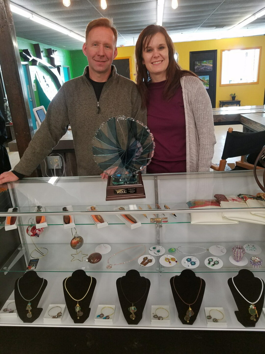 artisan forge founder greg johnson and his wife, krista, pose with the paragon award.