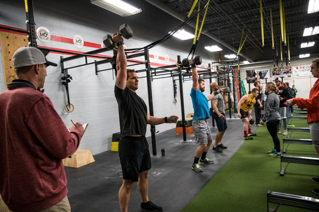 EVERY DAY IS ARMS DAY. Members of Momentum Fitness in Eau Claire have been competiting in a Friday Night Lights event to raise money for kids at DeLong Middle School.