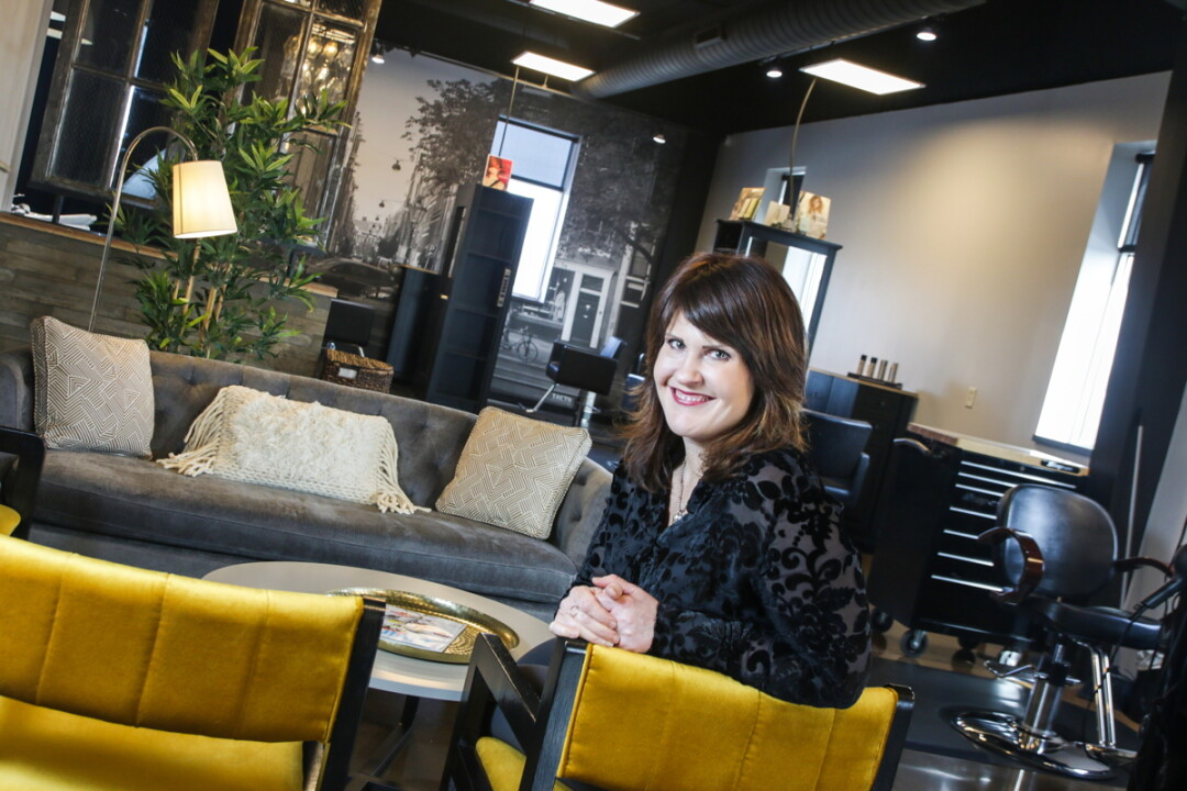 SITTING IN STYLE. Janelle Buesser recently opened Watermark Salon inside Eau Claire's Artisan Forge Studios.