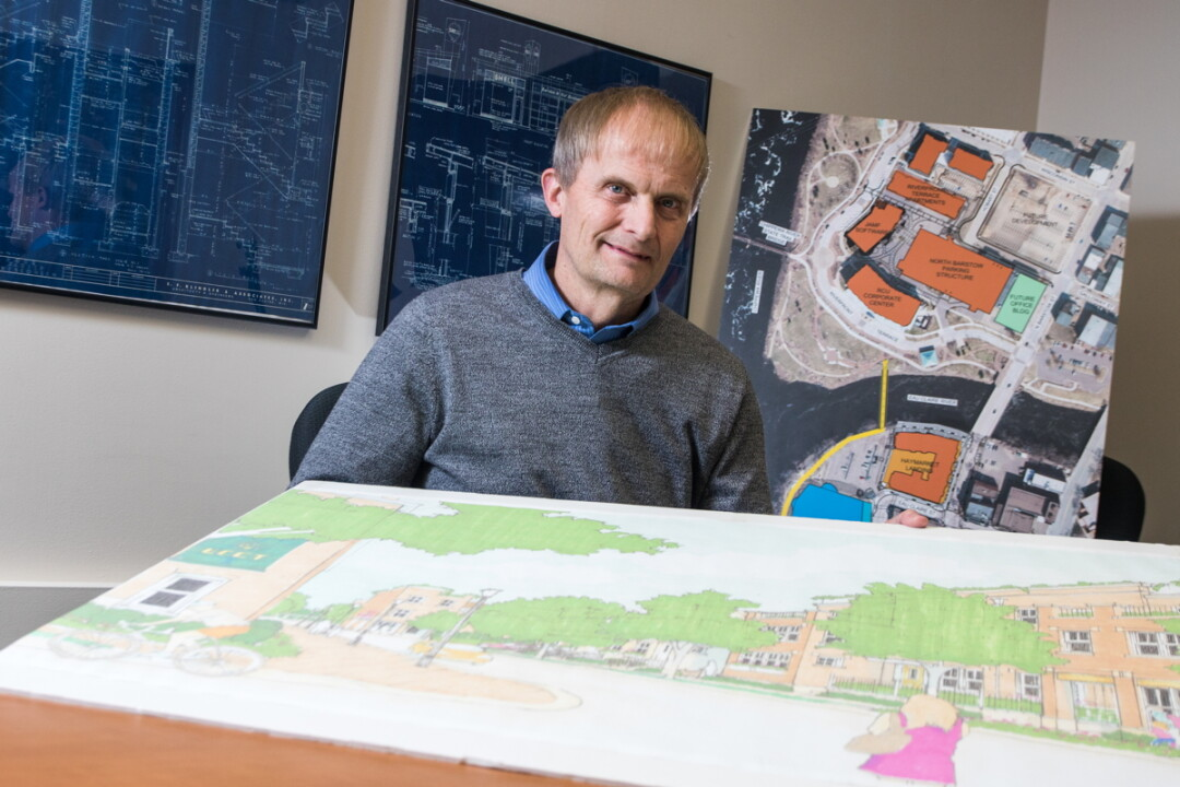 MAN WITH THE MAPS. Darryl Tufte retired March 1 after 33 years with the city of Eau Claire, first as city planner and then as community development director.