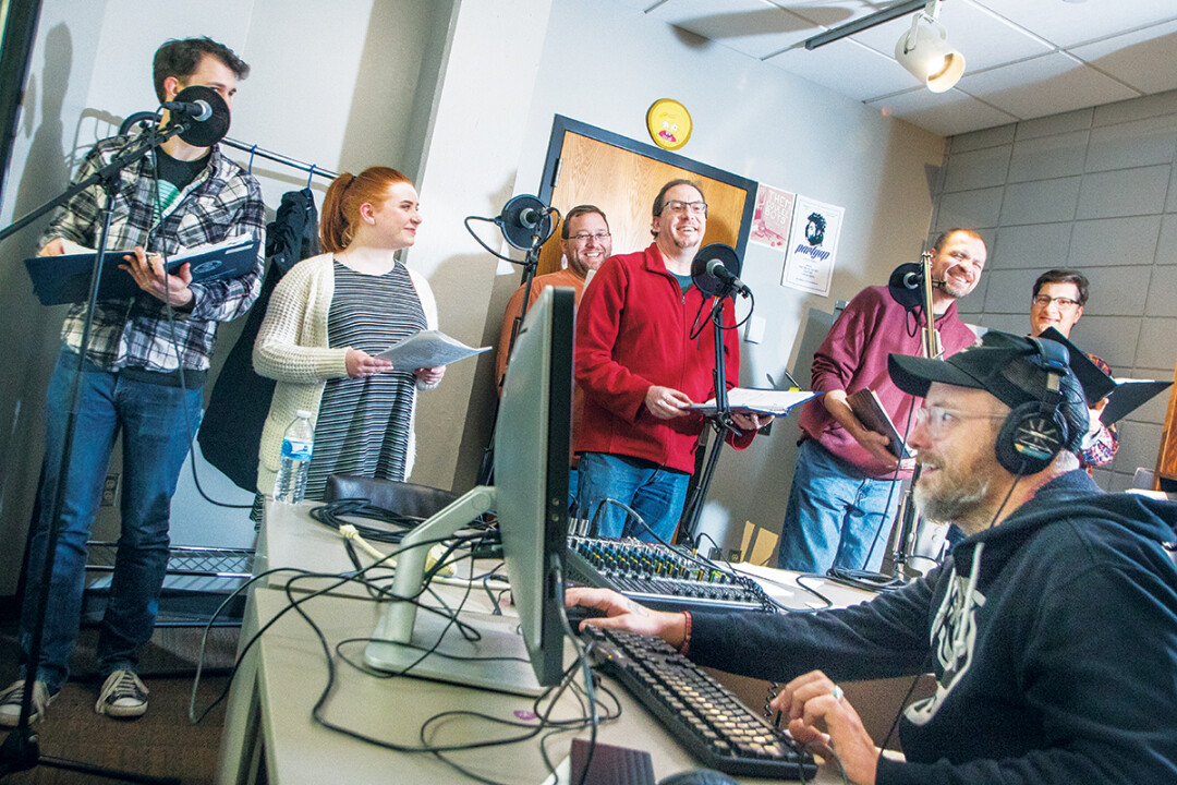 ATTACKING THE TRACKS. Above: Cast members of Bend in the River record dialogue at the Blugold Radio studios in UWEC's McIntyre Library.
