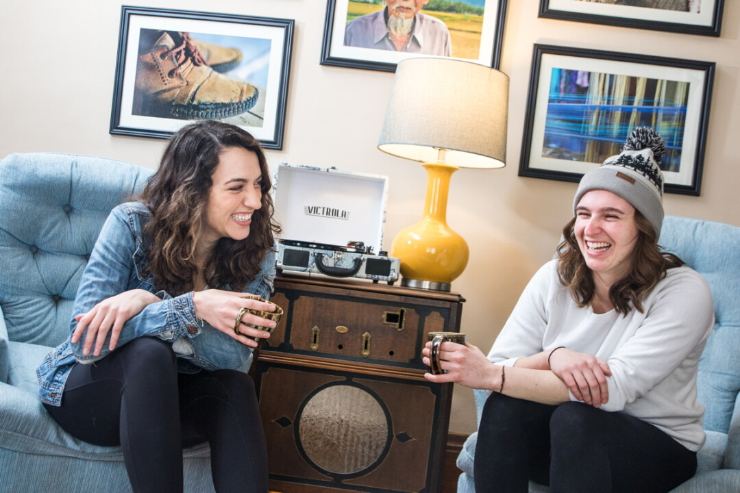 SIPS AND SMILES. Musical friends Cate Lucas (left) and Kelsey Nocek are Red Tide. The folk duo met while attending UW-Stevens Point and played their first show on a whim. Their debut album is out now.