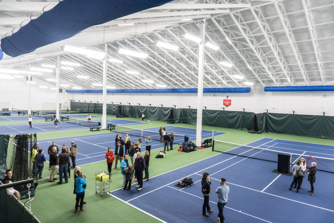 TENNIS, ANYONE? The new John & Fay Menard YMCA Tennis Center features eight indoor courts, state-of-the-art technology, and a viewing mezzanine. The facility's ribbon cutting was April 4.