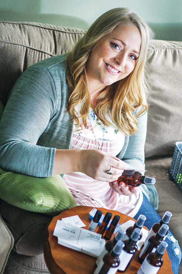 BOTTLE ROCKET. Melissa Wilson bottles and labels her line of Melnaturel bodycare products at home in Eau Claire.