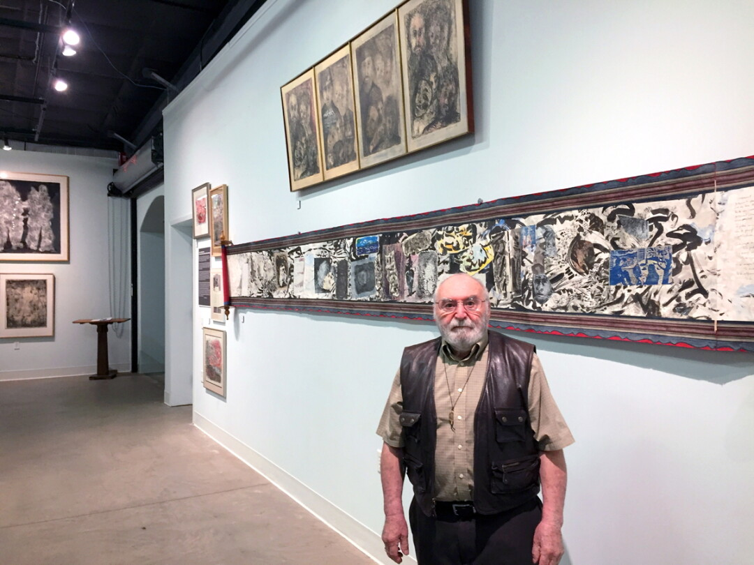 A LIFE IN ART. William Schulman, the founder of the UW-Stout art education department, creates large scroll collages, like the one on the wall behind him. An exhibit of work by Schulman and his wife, Shirley Siegel Schulman, is on display at the Rassbach Heritage Museum in Menomonie.