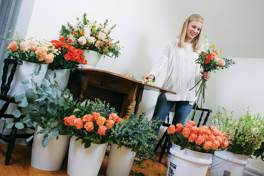 A BLOOM WITH A VIEW.  Mikelle Larson of Fersk Floral Artistry considers color, shape, and texture as she pulls together her flowery creations. She says she's inspired by both nature and modern design.