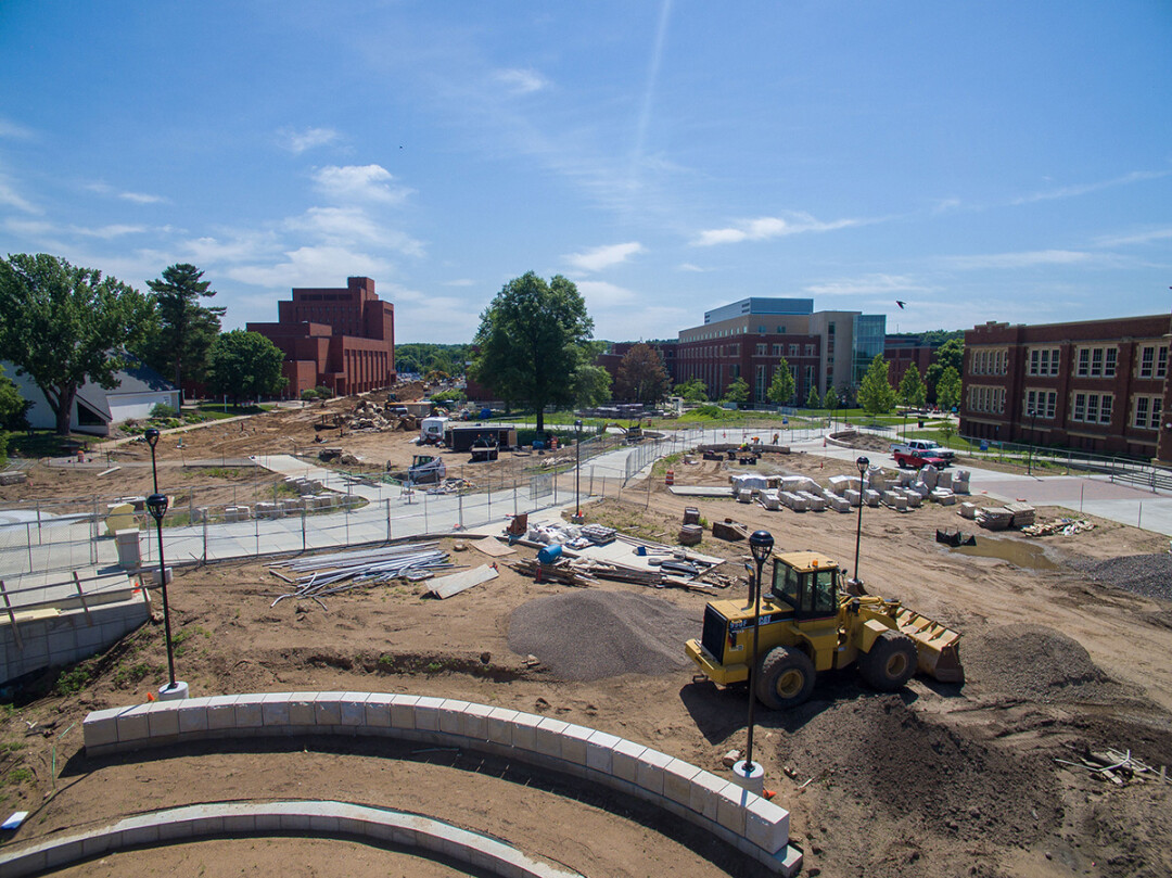 THE BIG DIG. Construction is ongoing this summer along Garfield Avenue on the UW-Eau Claire campus. The footbridge over the Chippewa River is at left.