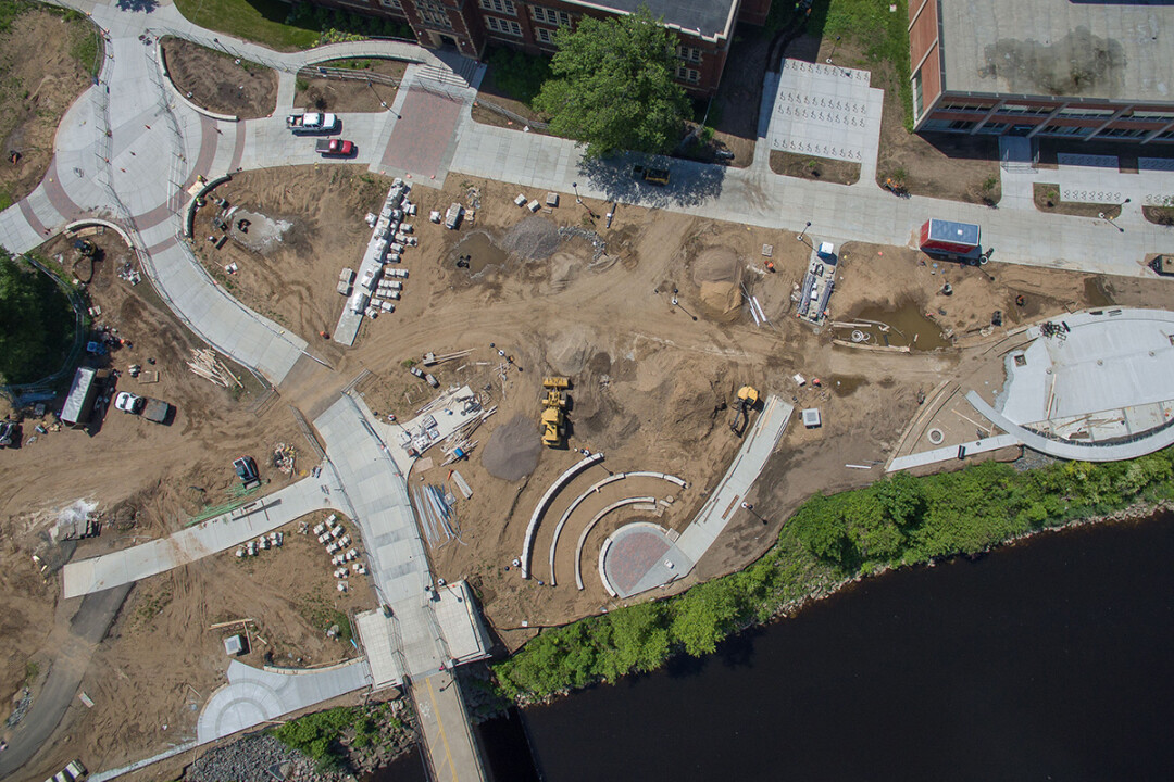 THINGS ARE TAKING SHAPE. This aerial photo shows the scale of the campus construction effort as of early June. Schofield Hall is at the top of the picture.