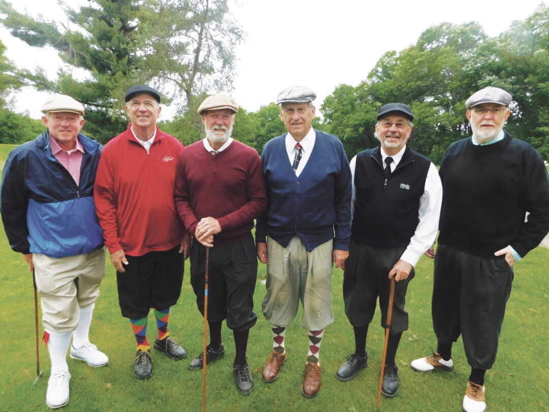 DRESSED FOR FAIRWAY SUCCESS. A group of hickory golf club enthusiasts gathered June 2 at Lake Hallie Golf Course for the second annual Lake Hallie Hickory Classic. The golfers, including David Morley, right, wore period clothing and used authentic hickory golf clubs, some of which are more than a century old.