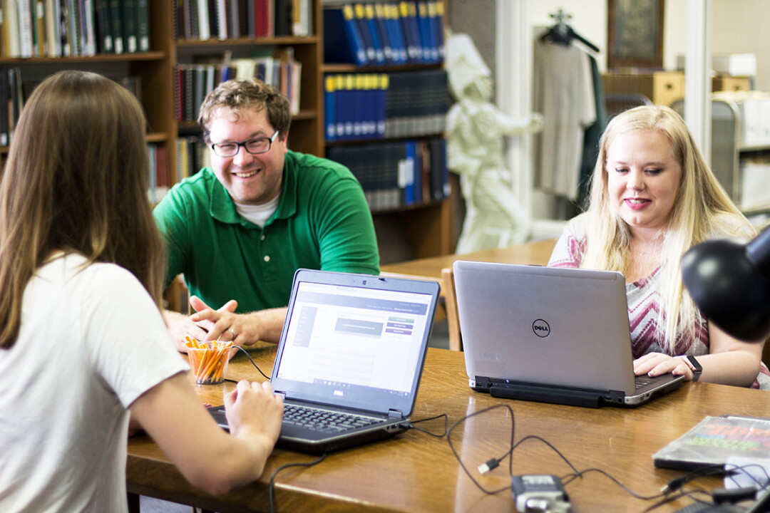 Greg Kocken, center, head of special collections at UW-Eau Claire's McIntyre Library, checked out the Sounds of Eau Claire website with summer student staff Karyssa Guilish, left, and Lizzy Schmidt.