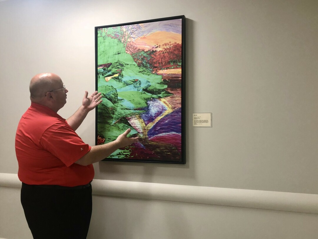 THEY'VE BEEN FRAMED! Regional Communications Director Matt Schneider talks about the local art at The New Marshfield Medical Center-Eau Claire Hospital, including this piece by Tom Gardner of Eau Claire.