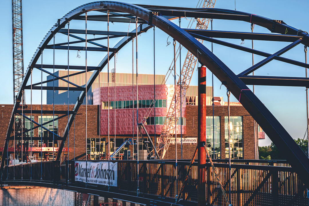 SPAN OF STEEL. The new pedestrian bridge connecting Phoenix Park to Haymarket Plaza was installed in early July. It was built by Anderson Bridges of Colfax.