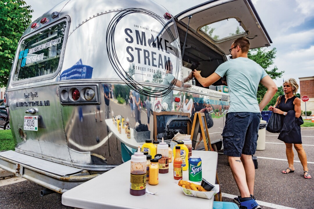 A SHINY SNACKMOBILE. Smokestream gleams even on overcast days as it serves up tacos, hot dogs, and mac'n'cheese to hungry patrons.