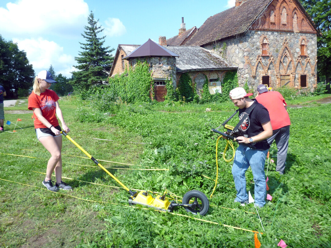 UWEC students Madeline Fuerstenberg and Joe Beck use ground-penetrating radar to search for buried structures at Rokiškis Manor, a Lithuanian museum and historical site.
