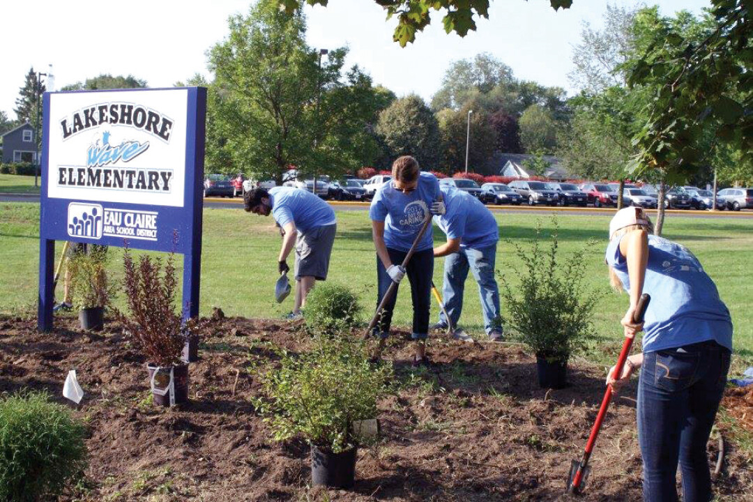 PITCHING IN. During last year's Day of Caring, volunteers landscaped at Lakeshore Elementary, painted for the Lowes Creek Little League (below), and helped out Habitat for Humanity (further below).