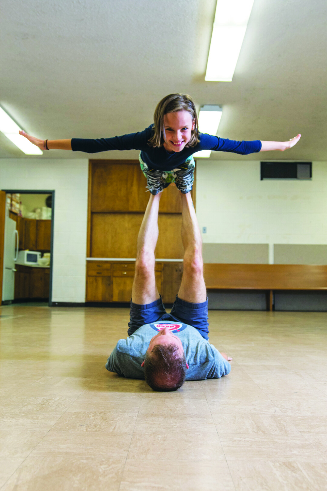 IT ALL COMES BACK. Joel Breed (Bruce Bechdel) and Charlotte Schaller (Small Alison) practice playing airplane for a touching scene in the Chippewa Valley Theatre Guild's production of Fun Home.