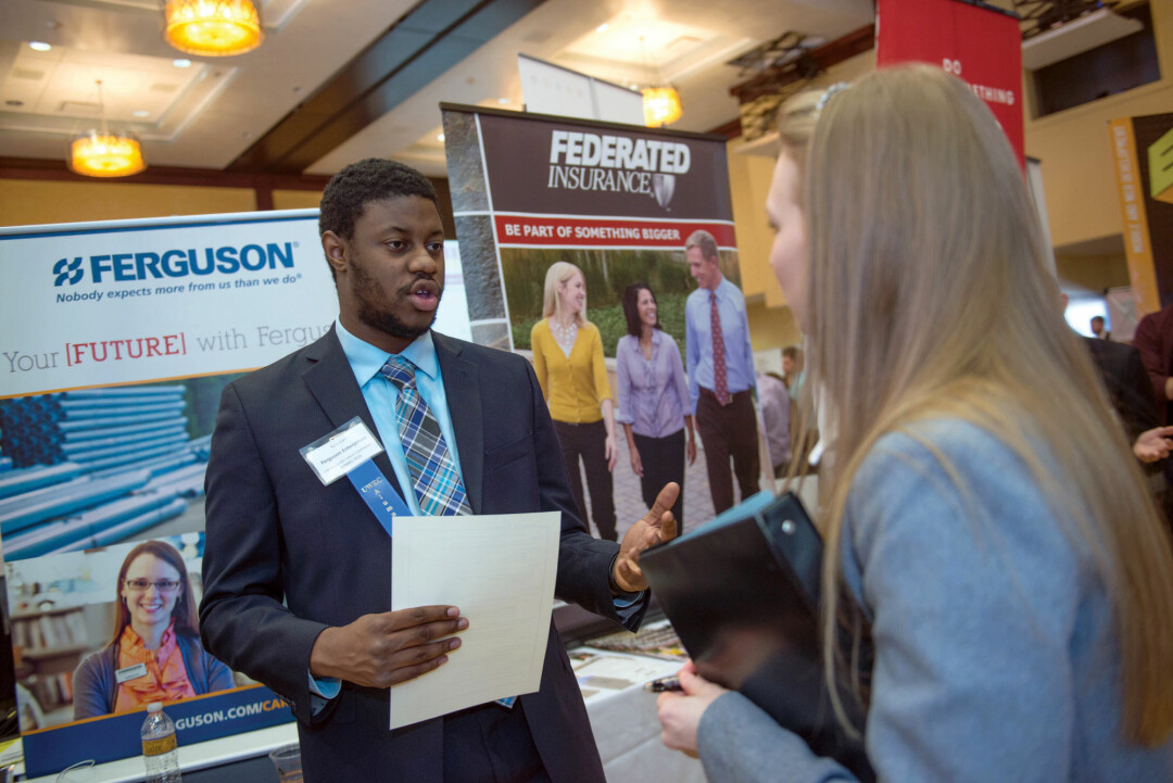 OPPORTUNITY KNOCKS. UW-Eau Claire students and recruiters mingle at a career conference. A new program aims to connect more students with local internships.