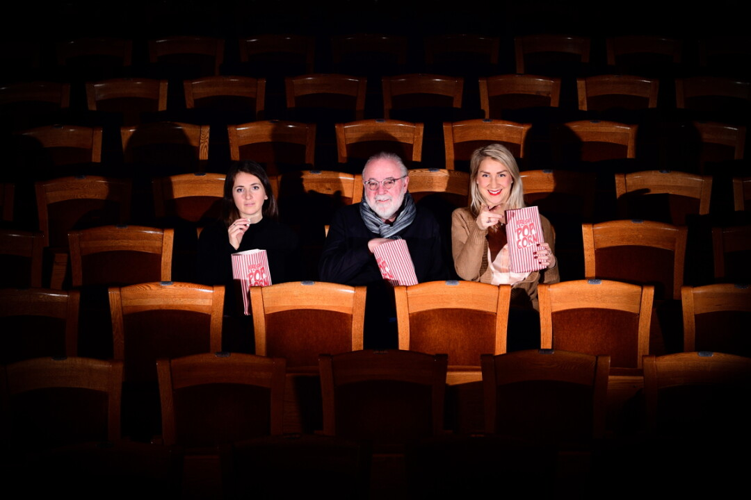 VIEWING PARTY. Red Cedar Film Festival organizers (left to right) Rebecca Thacker, Peter Galante, and Anna McCabe sit in Mabel Tainter Center for the Arts, one of two historic locations where the forthcoming festival will be held. More entries will be screened just across the street in UW-Stout's Harvey Hall.