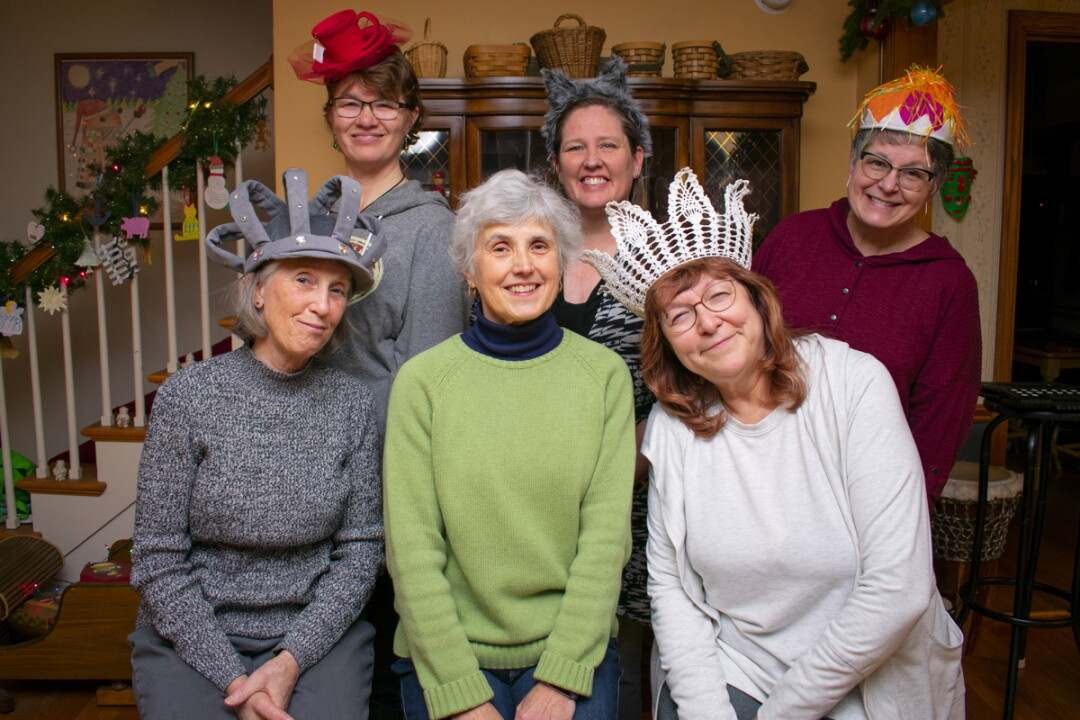 MAD HATTERS.  The Eau Claire Women in Theater don't usually use costumes, but the silly hats in Alice in Elderland help keep the many characters straight.