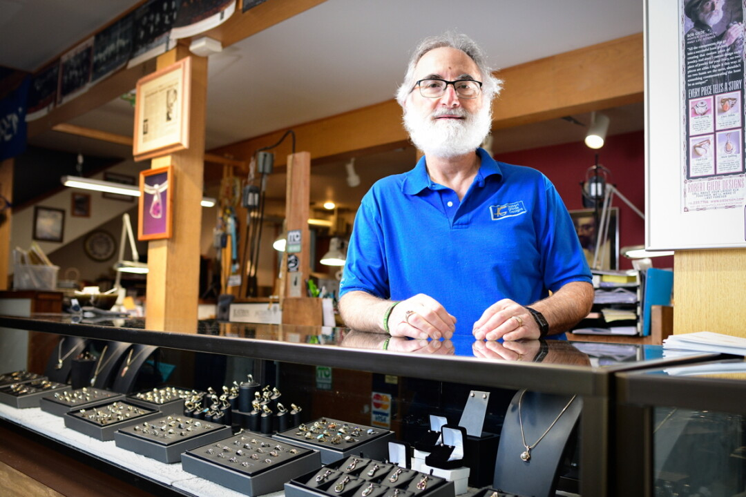 ALL THAT GLITTERS. Menomonie's Robert Giede has been handcrafting fine jewelry for over four decades. Besides traditional gemstones, Giede works with elk ivory, spent bullets, and much more.