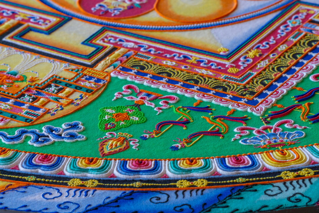 HANDY AND SANDY. The monks of the Drepung Loseling Monastery visited UW-Eau Claire from March 11-15 for an artist residency that included handcrafting an intricate sand mandala (above), lectures on Tibetan culture, traditions and beliefs, and a sacred music and dance performance.