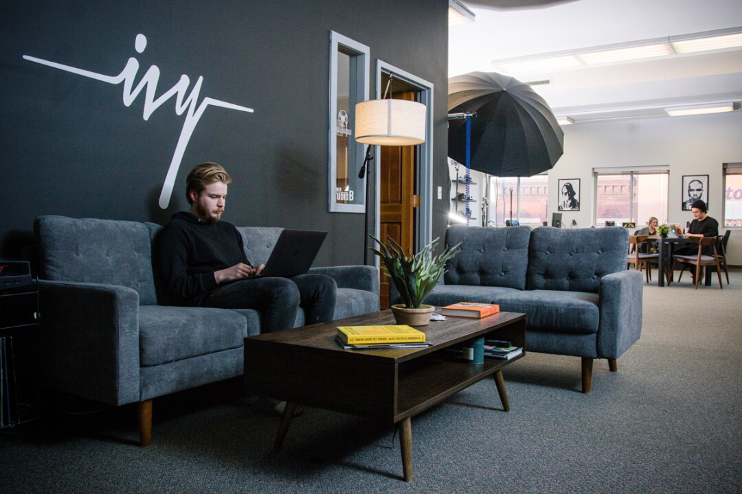 COUCHED IN CREATIVITY. Alak Phillips is one of the co-founders of Ivy Creatives, a new downtown Eau Claire co-working space.