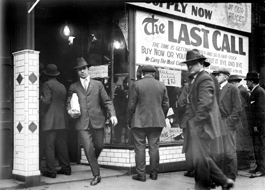 One last call for alcohol, so finish your whiskey or beer. Business was brisk at a Detroit liquor store on the eve of Prohibition in 1919.