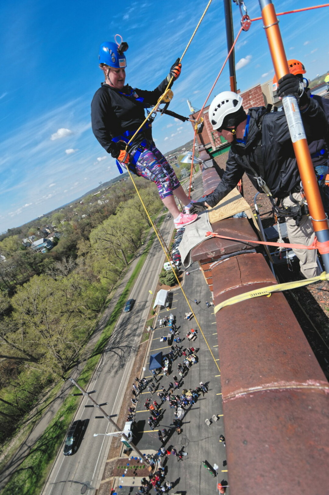 ONE OF THE EDGIEST PHOTOS VOLUME ONE HAS EVER PUBLISHED. On Saturday, May 11, locals rappelled down the side of Banbury Place on Galloway Street near downtown Eau Claire to help raise money for the Children's Dyslexia Center. See more photos at VolumeOne.org