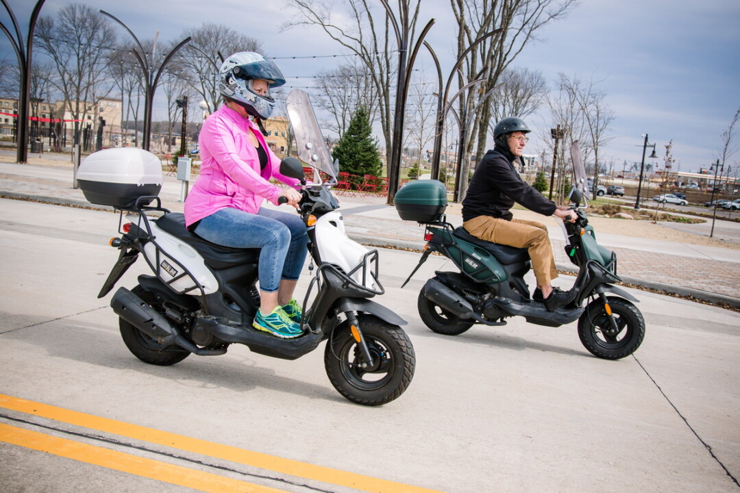 HITHER AND YON. Rolf and Jean Van Houten jet around Altoona and Eau Claire on their mopeds: with the warm weather comes adventure!