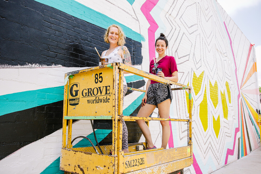 Mural maker Dez-Lezotte (right) with artist Britlyn Neumann.
