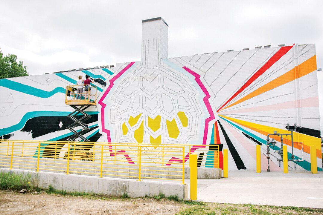 ALL HOPPED UP ON BIG ART. The Brewing Projekt's recently opened new brewery and event venue at 1807 N. Oxford Ave. now features a colorful mural by artist Dez Lezotte.