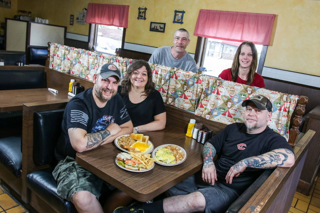 A DEDICATED CREW.  From left to right: New owners Brent and Dawn Knutson, utility man Kevin Kollwitz, server Marie Gunderson, and cook Mike Peterson.