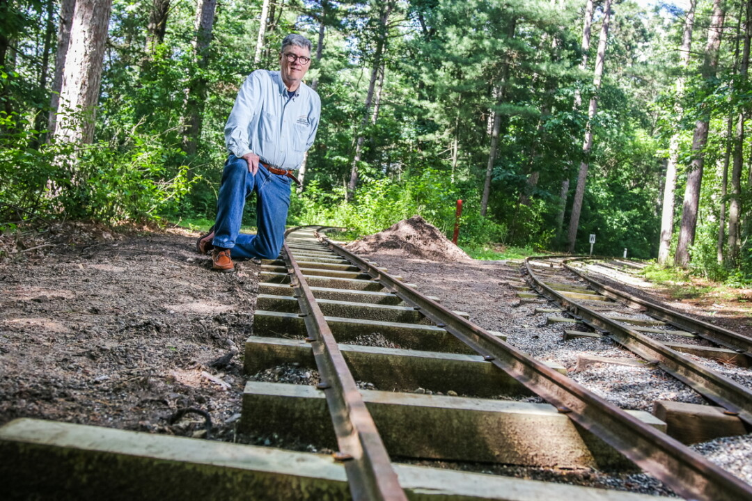 David Peterson of the Chippewa Valley Railroad Association poses with new track being added in Carson Park.