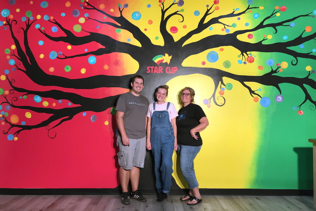 Artist Jessa Dressel,  center, with her brother Tyler and mother Becky.