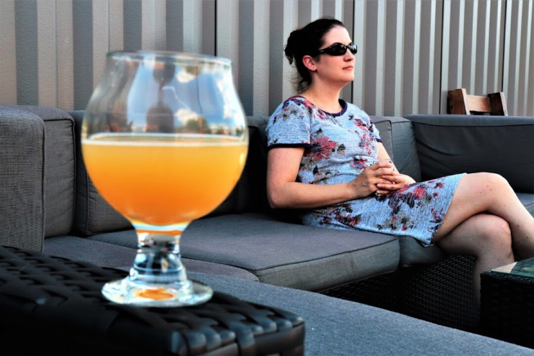 Our hero lounges, beer in hand, at the Brewing Projekt