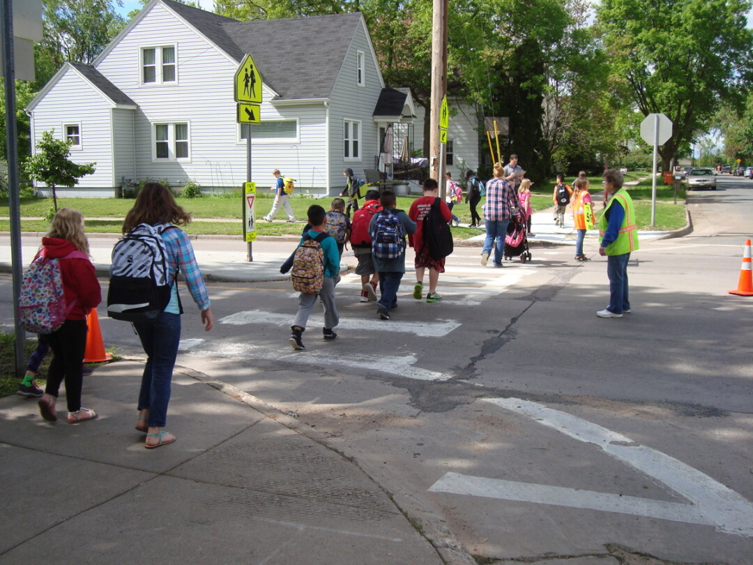STROLLING SAFELY. Children cross Birch Street on their way to Longfellow School. The school year begins Sept. 3 in the Eau Claire school district.