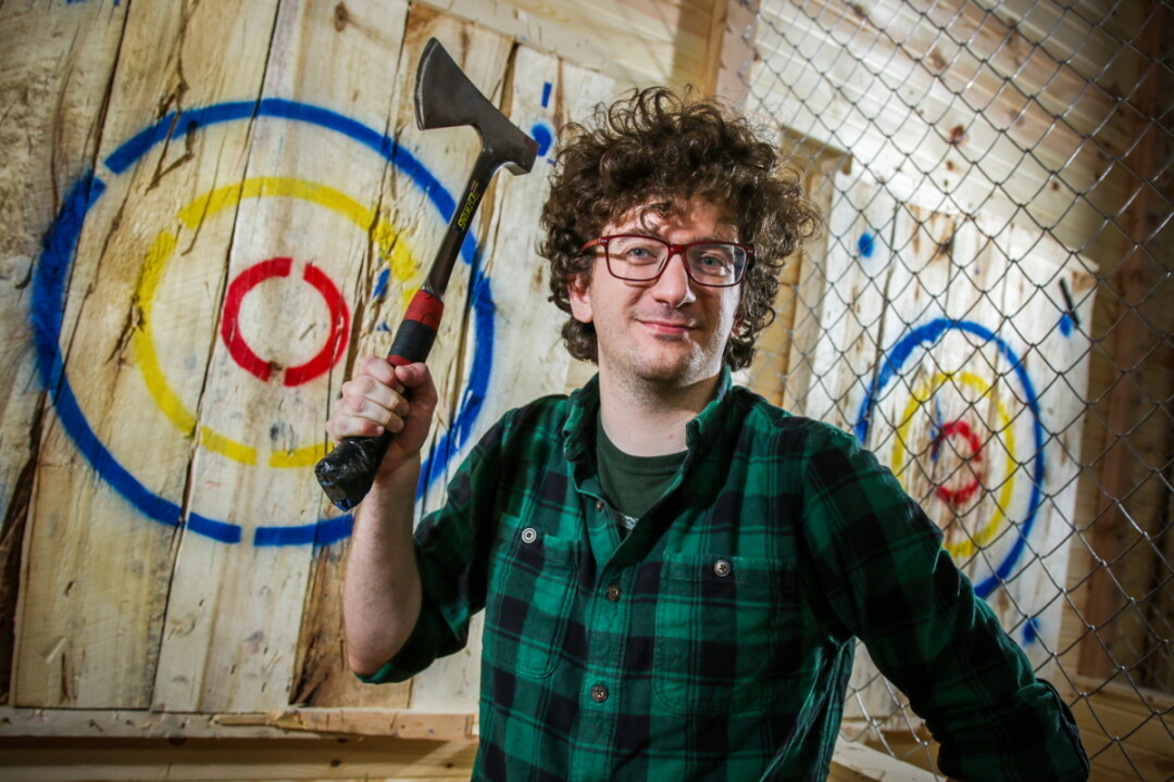 AXE-TION CITY. We sent one of our bravest and least-coordinated staffers to go try out the trendy new axe-throwing range at Action City in Eau Claire. He's a sharp guy, so we thought he'd have the chops for it.