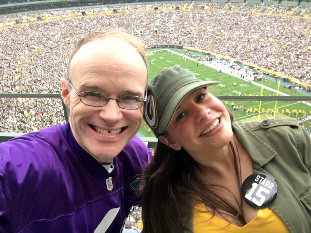 OPPOSITES ATTRACT. The writer and his wife prove that a Viking fan can survive a visit to Lambeau Field.