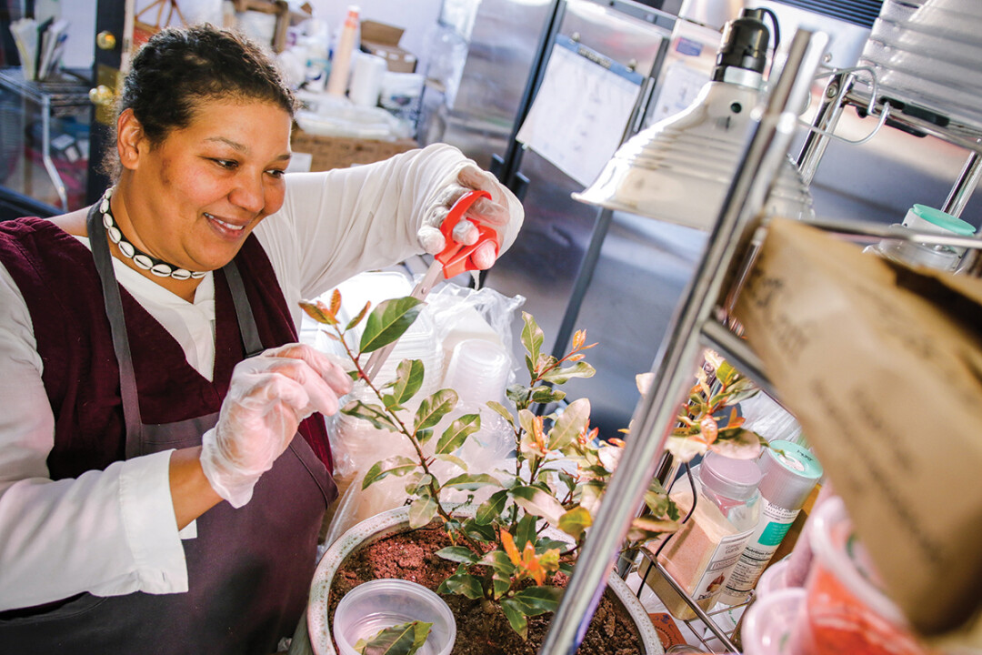 Serving up something special. Heidi Sanders, deli and catering manager for Just Local Foods, has more than 40 years of cooking experience. She grows her own bayleaf plant in the kitchen for seasoning soups.